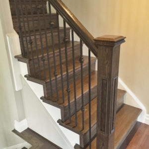 photo of stained wood stairs and handrail
