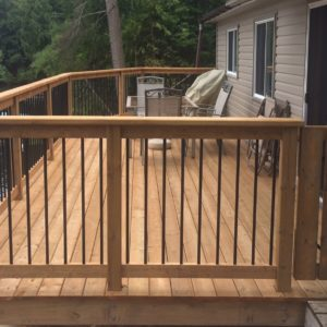photo of pressure treated railing with metal spindles