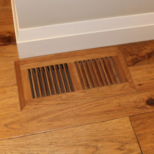 photo of flush mounted air vent in wood floor