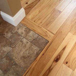 photo of tile with wood flooring