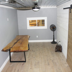 photo of Hickory flooring, Maple live edge table, rustic barn door hardware, T&G Pine wall with SamaN whitewash stain